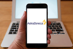 Using iPhone smartphone to display logo of Astrazenica , multinational pharmaceutical and biopharmaceutical company