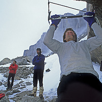 BAFFIN ISLAND, Canada.  Alex Lowe - who could do 400 pull-ups - works out in base camp, Great Sail Peak.