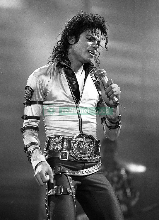 Jun 26, 2009 - Liverpool, Merseyside, United Kingdom - Michael Joseph Jackson (Aug. 29, 1958 - Jun. 25, 2009) American recording artist, entertainer, and businessman Ð the 'King of Pop.' Seventh child of the Jackson family, he debuted on the professional music scene at the age of 11 as a member of The Jackson 5. Solo career in 1971. ÊFive of his solo studio albums are among the world's best-selling records: Off the Wall (1979), Thriller (1982), Bad (1987), Dangerous (1991) and HIStory (1995). Jacko's MTV videos were legendary, such as 'Beat It', 'Billie Jean', 'Thriller', 'Black or White' and 'Scream' - credited for transforming the music video into an art form. Jackson popularized a number of physically complicated dance techniques, such as the robot and the moonwalk. Distinctive musical sound and vocal style influenced hip hop, pop and contemporary R&B artists. Personal life, included his changing appearance and behavior, generated significant controversy, damaging his public image. 1993 and 2005, accused of child sexual abuse, Jackson was not charged in 93 and acquitted in 2005. Jackson married twice and fathered three children. 13 Grammy Awards, 13 number one singles in his solo career - more than any other male artist and the sales of over 750 million albums worldwide. A big animal lover and philanthropist. Jackson's highly publicized personal life, coupled with his successful career, has made him a part of pop culture for almost four decades. PICTURED: Popstar MICHAEL JACKSON, performs at the legendary gig at Aintree Racecourse in September 1988, as part of the 'Bad World Tour.'  (Credit Image: © Mercury Press/ZUMA Press)