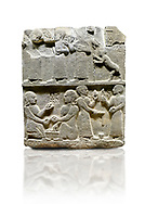 """Hittite monumental relief sculpted orthostat stone panel of Royal Buttress. Basalt, Karkamıs, (Kargamıs), Carchemish (Karkemish), 900 - 700 B.C. Anatolian Civilisations Museum, Ankara, Turkey.<br /> <br /> This panels scene showing 8 out of 10 children of the King, the hieroglyphs reads as follows: """"Malitispas, Astitarhunzas, Tamitispas,Isikaritispas, Sikaras, Halpawaris, Ya hilatispas"""". Above, there are three figures holding knucklebones (astragalus) and one figure walking by leaning on a stick; below are two each figures playing the knucklebones and turning whirligigs.  <br /> <br /> Against a white background. .<br />  <br /> If you prefer to buy from our ALAMY STOCK LIBRARY page at https://www.alamy.com/portfolio/paul-williams-funkystock/hittite-art-antiquities.html  - Type  Karkamıs in LOWER SEARCH WITHIN GALLERY box. Refine search by adding background colour, place, museum etc<br /> <br /> Visit our HITTITE PHOTO COLLECTIONS for more photos to download or buy as wall art prints https://funkystock.photoshelter.com/gallery-collection/The-Hittites-Art-Artefacts-Antiquities-Historic-Sites-Pictures-Images-of/C0000NUBSMhSc3Oo ."""