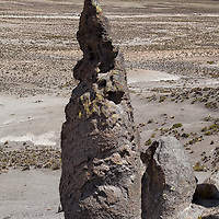 An eroded rock formation with view on the valley of Imata.