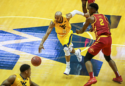 Feb 24, 2018; Morgantown, WV, USA; West Virginia Mountaineers guard Jevon Carter (2) dribbles between Iowa State Cyclones defenders during a fast break during the first half at WVU Coliseum. Mandatory Credit: Ben Queen-USA TODAY Sports