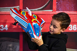 "© Licensed to London News Pictures. 13/11/2019. LONDON, UK. Harry (aged 7) plays with a PAW Patrol Mighty Plus Pups Super PAWS Mighty Jet Command Centre by Spin Master Toys at the preview of ""DreamToys"", the official toys and games Christmas Preview, held at St Mary's Church in Marylebone.  Recognised as the countdown to Christmas, the Toy Retailer's Association, an independent panel of leading UK toy retailers, have selected the definitive and most authoritative list of which toys will be the hottest property this Christmas.  Photo credit: Stephen Chung/LNP"