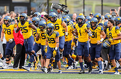 Sep 22, 2018; Morgantown, WV, USA; West Virginia Mountaineers players run onto the field before their game against the Kansas State Wildcats at Mountaineer Field at Milan Puskar Stadium. Mandatory Credit: Ben Queen-USA TODAY Sports