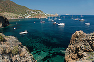 Yachts in the bay off Capo Milazzese on Panarea, The Aeolian Islands, Messina Province, Sicily, Italy