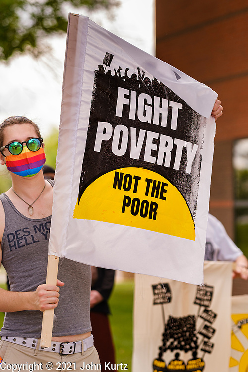 """07 JUNE 2021 - DES MOINES, IOWA: A Des Moines member of Moral Monday participates in a Moral Monday demonstration in Des Moines. About 20 representatives from The Poor People's Campaign in Des Moines gathered near the State Capitol for a """"National Call for Moral Revival."""" It was a part of a national effort to build a """"Third National Reconstruction."""" They called for a living wage that reflects the cost of living in Iowa (working at the state minimum wage, it takes 80 hours of work per week to afford a two bedroom apartment) and end military support for Iowa police agencies (between 2008-2014, Iowa law enforcement agencies got $7.7 million in military grade equipment.)         PHOTO BY JACK KURTZ"""