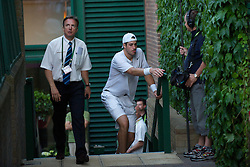 23.06.2010, Wimbledon, GBR, ATP World Tour, Grand Slam, Wimbledon, Men's singles, John Isner (USA) vs Nicolas Mahut (FRA), im Bild pulls himself up the stairs as he returns from a toilet break during his record-breaking marathon. EXPA Pictures © 2010, PhotoCredit: EXPA/ Propaganda/ D. Rawcliffe / SPORTIDA PHOTO AGENCY