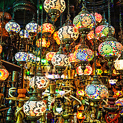 Istanbul's Grand Bazaar includes many stores selling brightly colored hanging lights with a teardrop design of colorful glass mosaics.