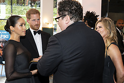 The Duke and Duchess of Sussex chat with film director Jon Favreau at the European Premiere of Disney's The Lion King at the Odeon Leicester Square, London.