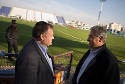 Bnei Sakhnin team owner Mazen Ghanayem, talks with Jewish friend and soccer agent Jozef Spiegel during half time of a qualifying game, Ramat Gan, Israel, Jan. 31, 2006. His team has a mixture of Israeli-Arab, Israeli, and foreign players. Football star Abbas Suan, himself an Israeli-Arab, who still faces criticism and racism resulting from the unsettled conflict between the Israelis and Palestinians.