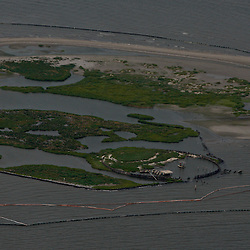 An aerial of the Chandeleur Islands in the Gulf of Mexico near the coast of Louisiana, U.S., on Wednesday, June 2, 2010. BP Plc has given up trying to plug its leaking well in the Gulf of Mexico any sooner than August, laying out a series of steps to pipe the oil to the surface and ship it ashore for refining, said Thad Allen, the U.S. government's national commander for the incident. Photographer: Derick E. Hingle
