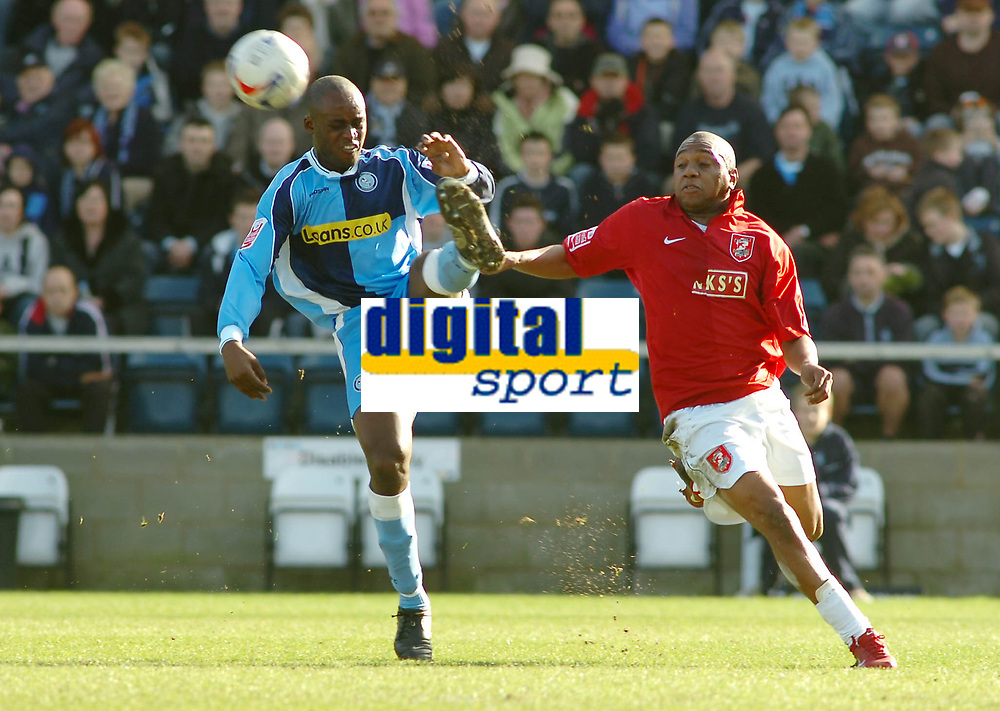 Photo: Kevin Poolman.<br />Wycombe Wanderers v Walsall. Coca Cola League 2. 17/03/2007. Leon Crooks of Wycombe (left) clears the ball from Hector Sam of Walsall of Wycombe