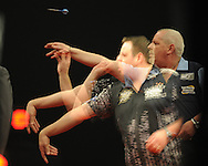 a multiple exposure image created in camera showing Adrian Lewis and  Robert Thornton in action..McCoy's Premier league darts, week 7 event at the Motorpoint Arena in Cardiff, South Wales on Thursday 21st March 2013. pic by Andrew Orchard, Andrew Orchard sports photography,