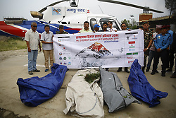 May 23, 2019 - Kathmandu, Nepal - A 12-member team including Nepal Army personnel brings four dead bodies on a helicopter for post mortem after being located during the Mount Everest cleanup campaign to clean the world's highest peak at Teaching Hospital in Kathmandu, Nepal on Thursday, May 23, 2019. (Credit Image: © Skanda Gautam/ZUMA Wire)