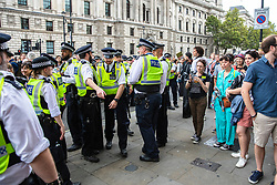 © Licensed to London News Pictures. 31/08/2019. London, UK. Police gather near Parliament Square as thousands gather to protest against the suspension of Parliament. The Queen has approved Prime Minister Boris Johnson's request to prorogue Parliament shortly after MPs return to work in September, a few weeks before the Brexit deadline of 31 October. Photo credit: Rob Pinney/LNP
