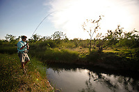 FLY ANGLER FISHING FOR SUNFISH IN THE PEASE RIVER, TEXAS