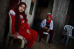 Huda Ghalia, 12, is seen with with her sister Omuma, 13, inside their home in Gaza, Palestinian Territories, Nov. 17, 2006. Huda gained attention after members of her family were killed in an explosion that Palestinians say was caused by Israeli artillery fire, a charge Israel denies. According to Human Rights Watch, since September 2005, Israel has fired about 15,000 rounds at Gaza while Palestinian militants have fired around 1,700 back.