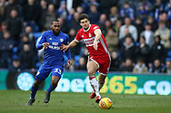 George Friend of Middlesbrough ® gets to the ball ahead of Junior Hoilett of Cardiff city..EFL Skybet championship match, Cardiff city v Middlesbrough at the Cardiff city Stadium in Cardiff, South Wales on Saturday 17th February 2018.<br /> pic by Andrew Orchard, Andrew Orchard sports photography.