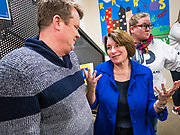 19 JANUARY 2020 - DES MOINES, IOWA: US Senator AMY KLOBUCHAR (D-MN), center, talks to people who came to see her during a campaign event at Urban Dreams in Des Moines. Sen. Klobuchar brought her presidential campaign to Urban Dreams, a community empowerment center in central Des Moines. Iowa hosts the first event of the presidential selection process in February. The Iowa Caucuses are Feb. 3, 2020.        PHOTO BY JACK KURTZ