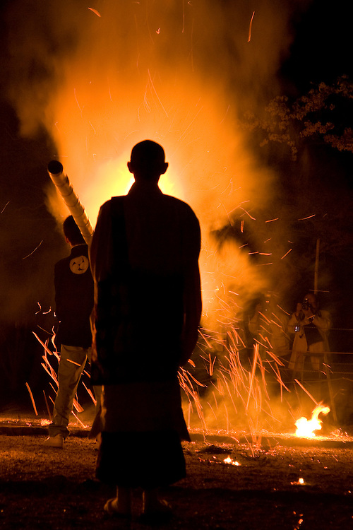 Asia, Japan, Honshu island, Nara, Shin-yakushiji Temple, Buddhist monk in procession with torches of fire at ceremony honoring Buddha's birthday