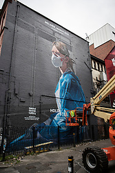 © Licensed to London News Pictures. 19/10/2020. Manchester, UK. Covid mural by artist Peter Barber for The National Portrait Gallery is finished in Northern Quarter, Manchester. Photo credit: Kerry Elsworth/LNP