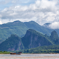 Leaving the Pak Ou caves, and cruising back to Luang Prabang on Mekong River.