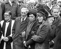 Marjorie Coulson, comforted by her father, 74 year old Richard Coulson, and a female family friend, at the funeral of her fiance, Senator Billy Fox, 35 years, Protestant, Fine Gael politician, Co Monaghan, Rep of Ireland, 14th March 1974. He was previously a TD (Irish MP).  Fox was visiting the home near Clones of his fiancee, Marjorie Coulson, which unknown to him had been taken over by thirteen armed paramilitaries. He ran from the scene but was followed and shot dead in a nearby field. Five members of the Provisional IRA were subsequently tried and convicted of the killing. 197403140164b.<br />