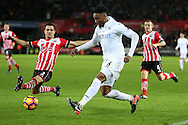 Leroy Fer of Swansea city is challenged by Cedric Soares of Southampton (l).  Premier league match, Swansea city v Southampton at the Liberty Stadium in Swansea, South Wales on Tuesday 31st January 2017.<br /> pic by  Andrew Orchard, Andrew Orchard sports photography.