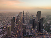 Aerial view of the traffic lanes and Skyscrapers in Dubai at sunset, U.A.E.