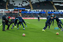 12 February 2017 - Premier League - Swansea City v Leicester City - A Sky cameraman trains his steady cam on the Swansea players as they warm up - Photo: Paul Roberts / Offside