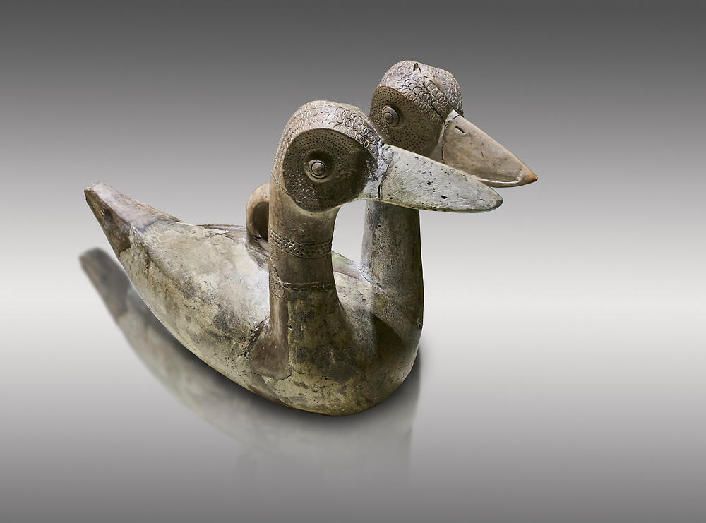 Hittite terra cotta ritual vessel in the shape of a duck with two heads - 16th century BC - Hattusa ( Bogazkoy ) - Museum of Anatolian Civilisations, Ankara, Turkey . Against gray background .<br /> <br /> If you prefer to buy from our ALAMY STOCK LIBRARY page at https://www.alamy.com/portfolio/paul-williams-funkystock/hittite-art-antiquities.html  - Type Hattusa into the LOWER SEARCH WITHIN GALLERY box. Refine search by adding background colour, place, museum etc<br /> <br /> Visit our HITTITE PHOTO COLLECTIONS for more photos to download or buy as wall art prints https://funkystock.photoshelter.com/gallery-collection/The-Hittites-Art-Artefacts-Antiquities-Historic-Sites-Pictures-Images-of/C0000NUBSMhSc3Oo