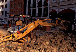 Stock photo of a driver operating a front-end loader during city street improvements in downtown Houston.