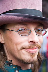 Young man wearing a hat; smiling; at the Cropredy Festival  Fairport's Cropredy Convention  2005,