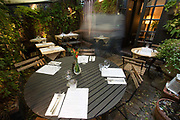 Aurora Restaurant on 7th October 2015 in London, United Kingdom. A Cosy modern European restaurant with art hanging from the walls, wine-bottle candles and a lush patio garden in Carnaby, London.
