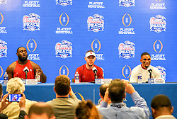 Oklahoma Sooners defensive lineman Neville Gallimore (90),  head coach Lincoln Riley and  quarterback Jalen Hurts (1) at the press conference after  the 2019 College Football Playoff Semifinal at the Chick-fil-A Peach Bowl on Saturday, Dec. 28, in Atlanta. (Marvin Gentry via Abell Images for the Chick-fil-A Peach Bowl)