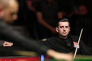 Mark Selby (Eng) looks on from his chair at Barry Hawkins (Eng). Barry Hawkins (Eng) v Mark Selby (Eng) , Quarter-Final match at the Dafabet Masters Snooker 2017, at Alexandra Palace in London on Friday 20th January 2017.<br /> pic by John Patrick Fletcher, Andrew Orchard sports photography.