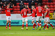 GOAL - 1-0. Charlton Athletic forward Conor Washington (14) celebrates with teammates after scoring a goal during the EFL Sky Bet League 1 match between Charlton Athletic and AFC Wimbledon at The Valley, London, England on 12 December 2020.