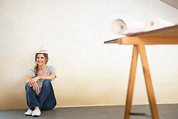 Woman decorating new home tired taking a break
