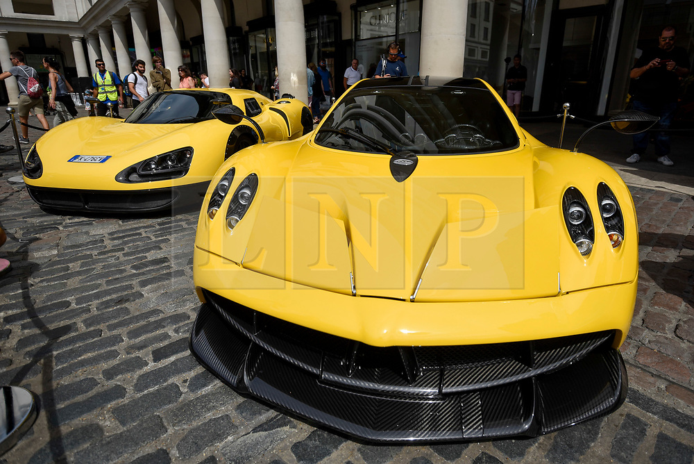 © Licensed to London News Pictures. 04/08/2018. LONDON, UK. (L to R) An EC Only One P8 (handmade in Italy from aluminium and carbon fibre) and a Pagani Huayra, parked up in Covent Garden for Gumball 3000, a charity race for supercars and more.  150 cars will journey from London to Tokyo in a race which commences on Sunday 5 August.  Photo credit: Stephen Chung/LNP