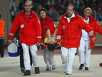23/11/2004 - UEFA Champions League - Group A - AS Monaco v Liverpool  - Stade Louis II, Monte Carlo<br />Liverpool's Luis Garcia holds his face in agony as he is carried away on a stretcher after pulling up with a hamstring injury in the first minute of the game.<br />Photo:Jed Leicester/Back Page Images
