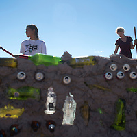 092014      Cayla Nimmo<br /> <br /> Jared Tyler and Katrina Turner work on making mud and straw to be used on constructing a wall around the community garden using recycled bottles and cans on Saturday in Lupton