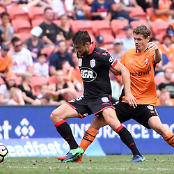 BRISBANE, AUSTRALIA - DECEMBER 11: Thomas Kristensen of the Roar and James Holland of Adelaide United compete for the ball during the round 10 Hyundai A-League match between the Brisbane Roar and Adelaide United at Suncorp Stadium on December 11, 2016 in Brisbane, Australia. (Photo by Patrick Kearney/Brisbane Roar)