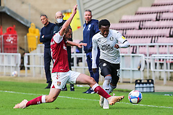 Siriki Dembele of Peterborough United skips past Michael Harriman of Northampton Town - Mandatory by-line: Joe Dent/JMP - 10/10/2020 - FOOTBALL - PTS Academy Stadium - Northampton, England - Northampton Town v Peterborough United - Sky Bet League One