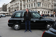 Licensed taxi drivers block the traffic in Parliament Square between 1pm-4pm in protest against traffic policies, 11th of February 2019, Central London, United Kingdom.The disgruntled taxi drivers feel squeezed by local government transport policies. They say they will continue their protest and blockade the square every other day the same time until they feel the Mayor of London listens to them.