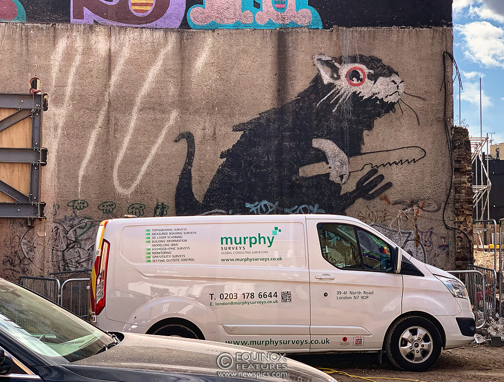 London, United Kingdom - 15 August 2019<br /> EXCLUSIVE SET - Aerial construction specialists and demolition experts use a huge crane to carefully lift intact, a twenty five ton, two-story wall, to preserve a famous Banksy rat image which has been covered up for years. Teams from specialist companies have spent over six weeks cutting around the artwork and fitting custom made eight ton steel supports to enable them to save the historic piece of art. Work has started on the construction of a new twenty seven floor art'otel hotel on the site of the old Foundry building in Shoreditch, east London, and a condition of the planning permission was to preserve the historical Banksy graffiti. A second section of the painting, an image of a TV being thrown through a broken window has already been cut out and moved separately. After the hotel construction is complete the two parts of the Banksy painting will be displayed on the hotel. Our pictures show the stages of work to protect the image, culminating in the lifting of the three story wall by crane. Video footage also available.<br /> (photo by: EQUINOXFEATURES.COM)<br /> Picture Data:<br /> Photographer: Equinox Features<br /> Copyright: ©2019 Equinox Licensing Ltd. +443700 780000<br /> Contact: Equinox Features<br /> Date Taken: 20190815<br /> Time Taken: 154456<br /> www.newspics.com