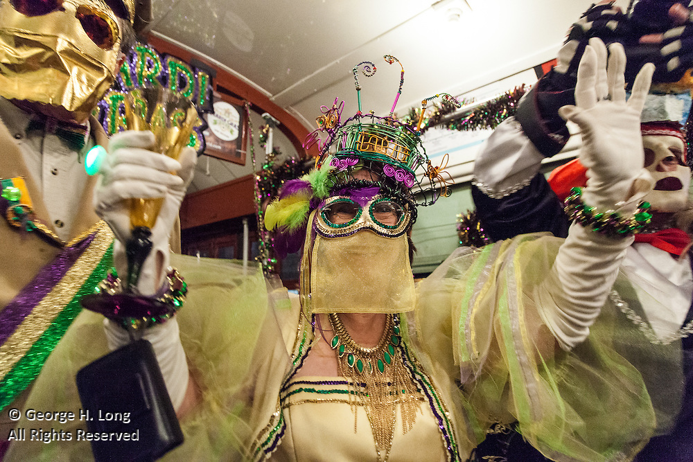 The Phunny Phorty Phellows ride the St. Charles Avenue streetcar heralding the arrival of the Carnival season on Twlefth Night, leading to Mardi Gras in New Orleans