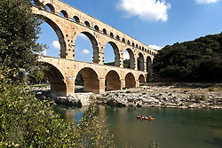 Paddlers on the Gardon River approach the Pont du Gard.  Built by the Romans circa 19 B.C., this wonder of stone was a major link in a 30-mile canal that brought water to Nimes.  It is the world's second highest standing Roman structure.
