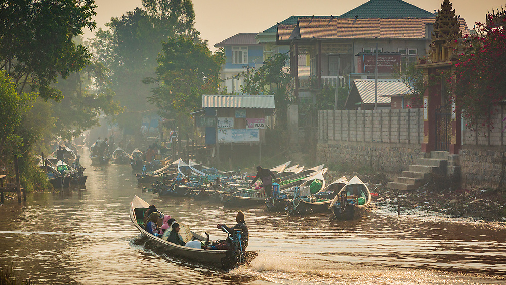 River and lake taxis gathering at dusk in Nyuang Schwe (ေညာင္ေရႊ) on the northern end of Lake Inle, Myanmar / Burma. A growing travellers destination with both fascinating local markets as well as a growing tourist and backpacker scene.