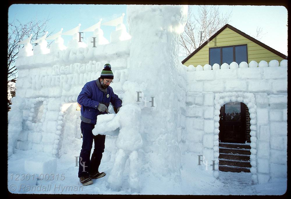 Bob Spangenberg works on castle that won snow-sculpture contest of St. Paul Winter Carnival. Minnesota