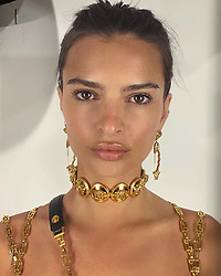 """Emily Ratajkowski releases a photo on Instagram with the following caption: """"fitting headshot @versace"""". Photo Credit: Instagram *** No USA Distribution *** For Editorial Use Only *** Not to be Published in Books or Photo Books ***  Please note: Fees charged by the agency are for the agency's services only, and do not, nor are they intended to, convey to the user any ownership of Copyright or License in the material. The agency does not claim any ownership including but not limited to Copyright or License in the attached material. By publishing this material you expressly agree to indemnify and to hold the agency and its directors, shareholders and employees harmless from any loss, claims, damages, demands, expenses (including legal fees), or any causes of action or allegation against the agency arising out of or connected in any way with publication of the material."""